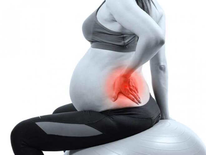 Почему болит спина у беременных на поздних сроках 51