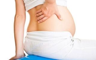 Почему болит спина при беременности — причины появления + безопасные методы лечения